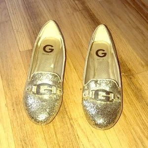 Gold glitter shoes by guess.